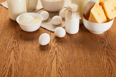 Various fresh organic dairy products and eggs on rustic wooden table stock vector