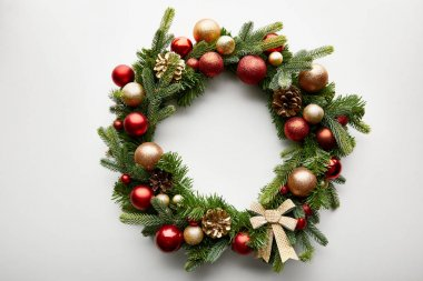 Top view of festive Christmas wreath with baubles on white background stock vector