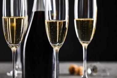 Glasses and bottle of champagne for celebrating christmas on black stock vector