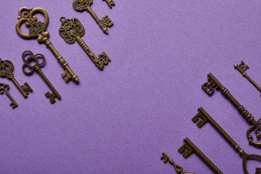 Top view of vintage keys on violet background stock vector