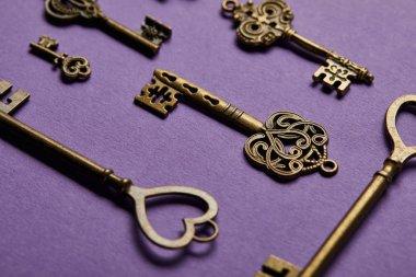 Close up view of vintage keys on violet background stock vector