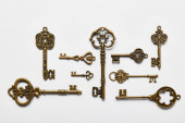 top view of vintage keys on white background