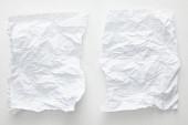horní pohled na prázdné zmačkané papírové listy na bílém pozadí