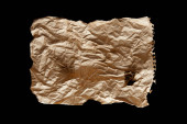 Photo top view of empty crumpled and burnt vintage paper isolated on black