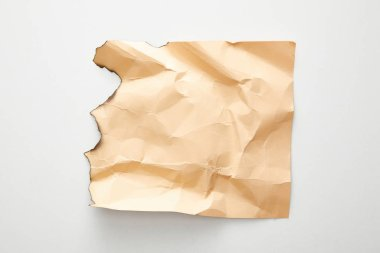 Top view of empty crumpled and burnt beige vintage paper on white background stock vector