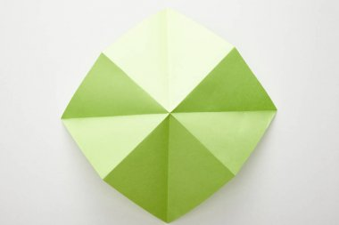 Top view of empty green origami paper on white background stock vector
