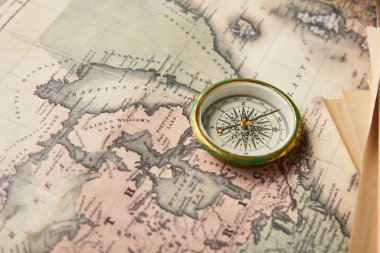 vintage compass on map background