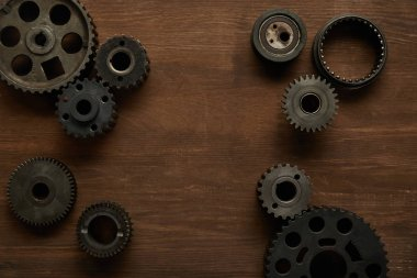 top view of aged gears on wooden table