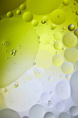 abstract green and grey color background from mixed water and oil bubbles