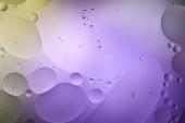Fényképek elvont lila és zöld színű háttér vegyes víz és olaj buborékok