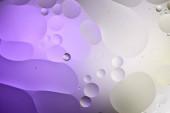 Fényképek elvont lila és szürke színű textúra vegyes víz és olaj buborékok