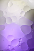 Fotografie creative purple and grey color texture from mixed water and oil bubbles