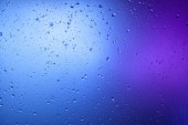 Beautiful abstract background from mixed water and oil in blue and purple color