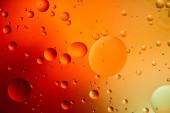 elvont narancs és piros színű háttér vegyes víz és olaj