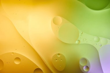 Beautiful abstract background from mixed water and oil in orange and green color stock vector