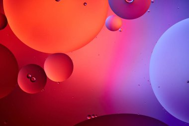 Creative abstract background from mixed water and oil bubbles in pink and purple color stock vector