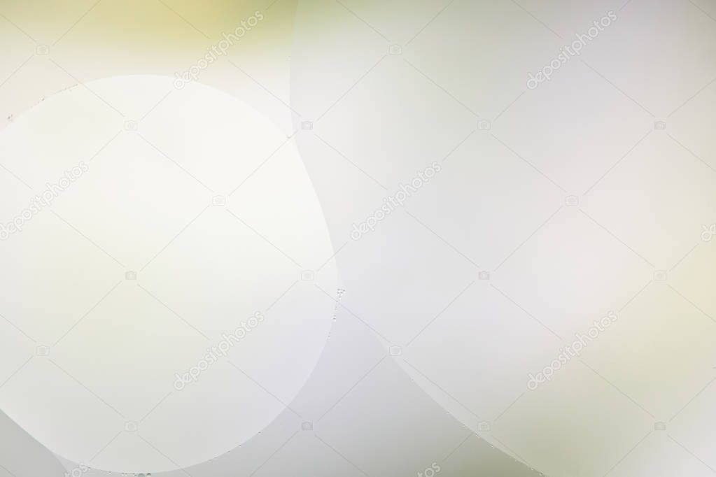Abstract background from mixed water and oil in light green and grey color stock vector