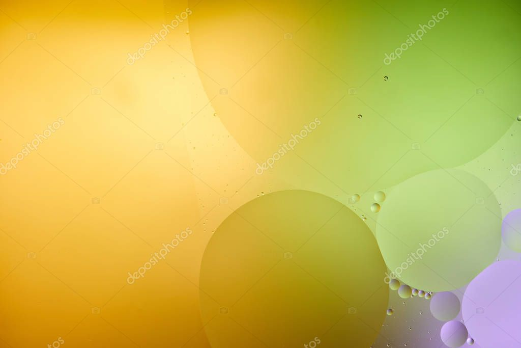 Beautiful abstract background from mixed water and oil in purple, orange and green color stock vector