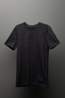 Blank basic black t-shirt on grey background stock vector