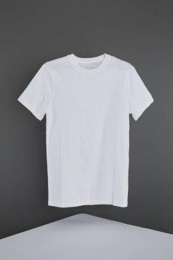 Blank basic white t-shirt on grey background stock vector