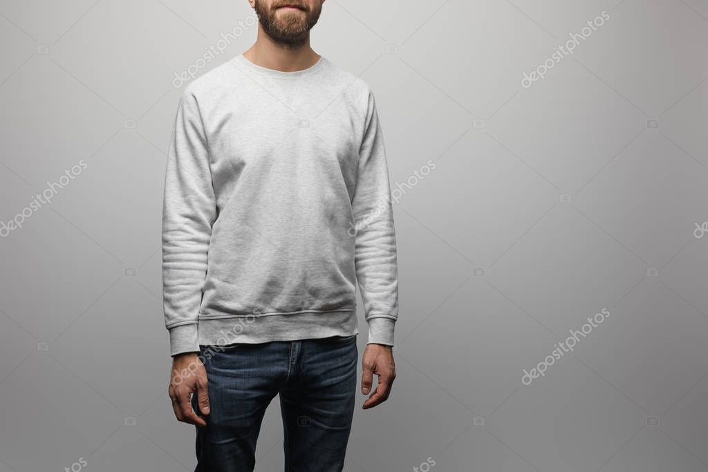 Partial view of bearded man in blank basic grey sweatshirt isolated on grey stock vector
