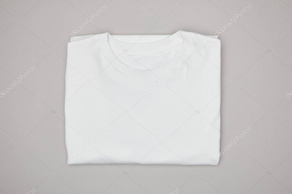 Top view of blank basic white t-shirt isolated on grey stock vector