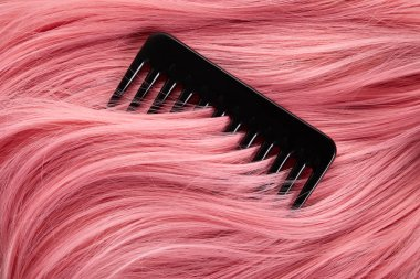 Top view of comb on colored pink hair
