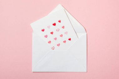 Top view of greeting card with hearts in white envelope isolated on pink stock vector