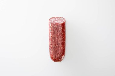 Top view of delicious whole salami isolated on white stock vector