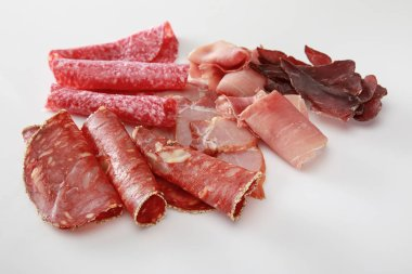 Fresh delicious assorted sliced meat isolated on white stock vector