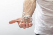 selective focus of man holding small souvenirs from paris isolated on white