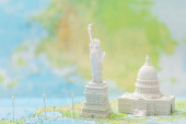 small figurines with american attractions on map with pins