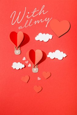 Top view of paper heart shaped air balloons in clouds near with all my lettering on red background stock vector