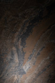 top view of textured and dark granite surface