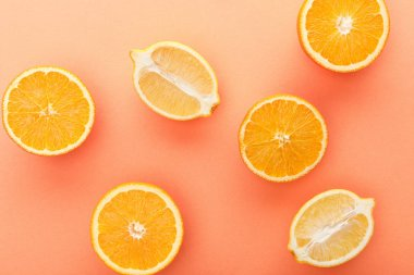Top view of citrus fruits halves on orange background stock vector