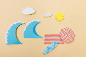 Top view of paper cut summer beach on beige background