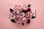 Photo top view of blooming spring flowers in bouquet on pink background, mom illustration