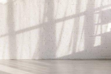 Sunlight and shadows on brick wall in empty yoga studio stock vector