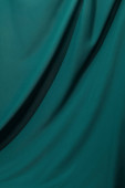 close up view of emerald soft and wavy silk fabric