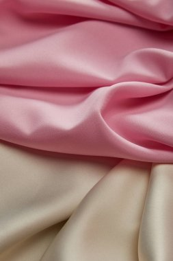 Close up view of satin pink and white soft and wavy fabric stock vector