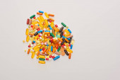 Top view of colorful pills isolated on white