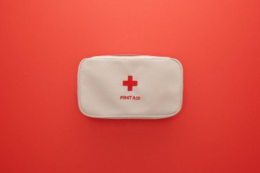 Top view of first aid kit isolated on red stock vector