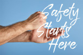 partial view of man washing hands isolated on blue, safety starts here illustration