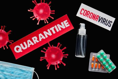 Top view of papers with quarantine and coronavirus lettering near medical mask, pills and hand sanitizer isolated on black stock vector