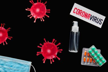Top view of paper with coronavirus lettering near medical mask, pills and hand sanitizer isolated on black stock vector