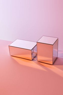 Cubes with light reflection on surface on pink background stock vector