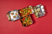 delicious chinese food in takeaway boxes on red