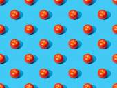 fresh tomatoes on blue colorful background, seamless pattern