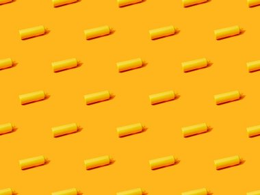 Bottles of mustard on orange colorful background, seamless pattern stock vector