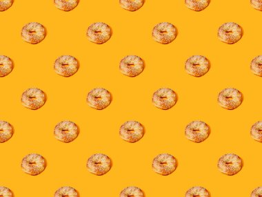 Fresh buns on orange colorful background, seamless pattern stock vector